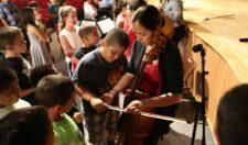Artist working with children at Geneva North Street Elementary School.