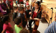 Artists talking to children at Geneva North Street elementary school.