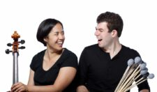 Photo of a cellist and percussionist.